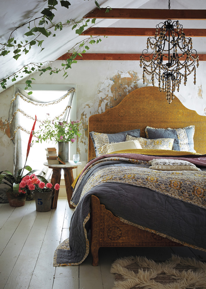 earthy chic bedroom idea with ethnic bed with headboard colorful bed sheet slanted roof with vivid floral decoration maple bedside table some vivid flowers on decorative pots