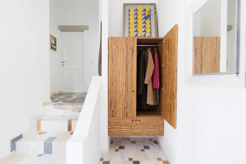 eclectic closet design with floating base and wooden material