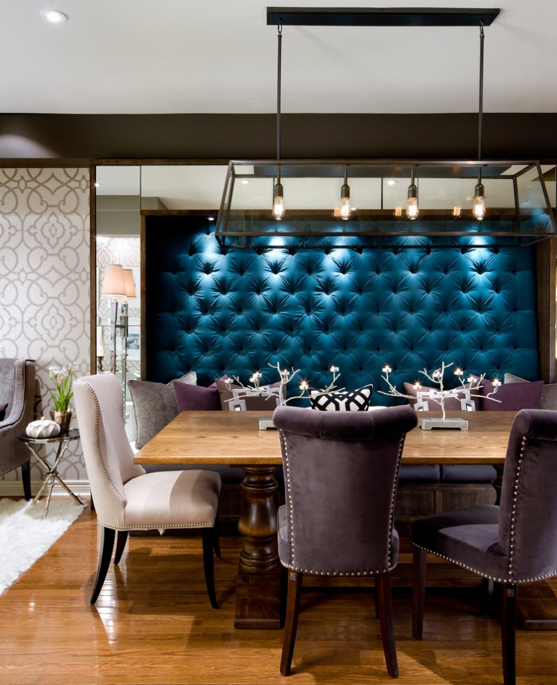 elegant big banquette set with white and grey chairs, blue tufted back wall, pendant