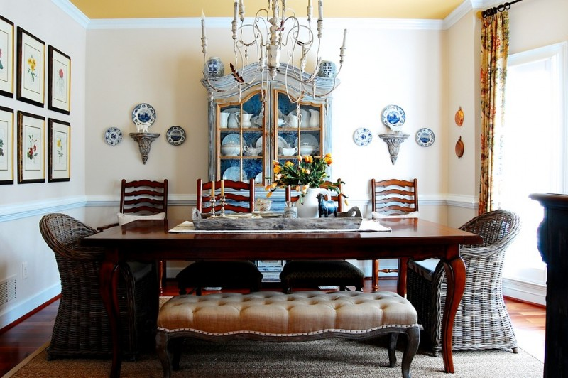farmhouse dining room set with two rattan couch, two wooden chair, a bench with tufted cushion