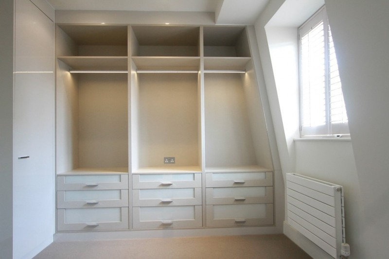 fitted walk in closet in white the window with white shutter light beige flooring idea