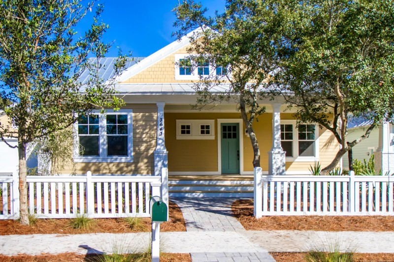 fresh colored exterior home idea with decorative small windows pull up exterior windows with white trims green colored entrance door three series of windows at top