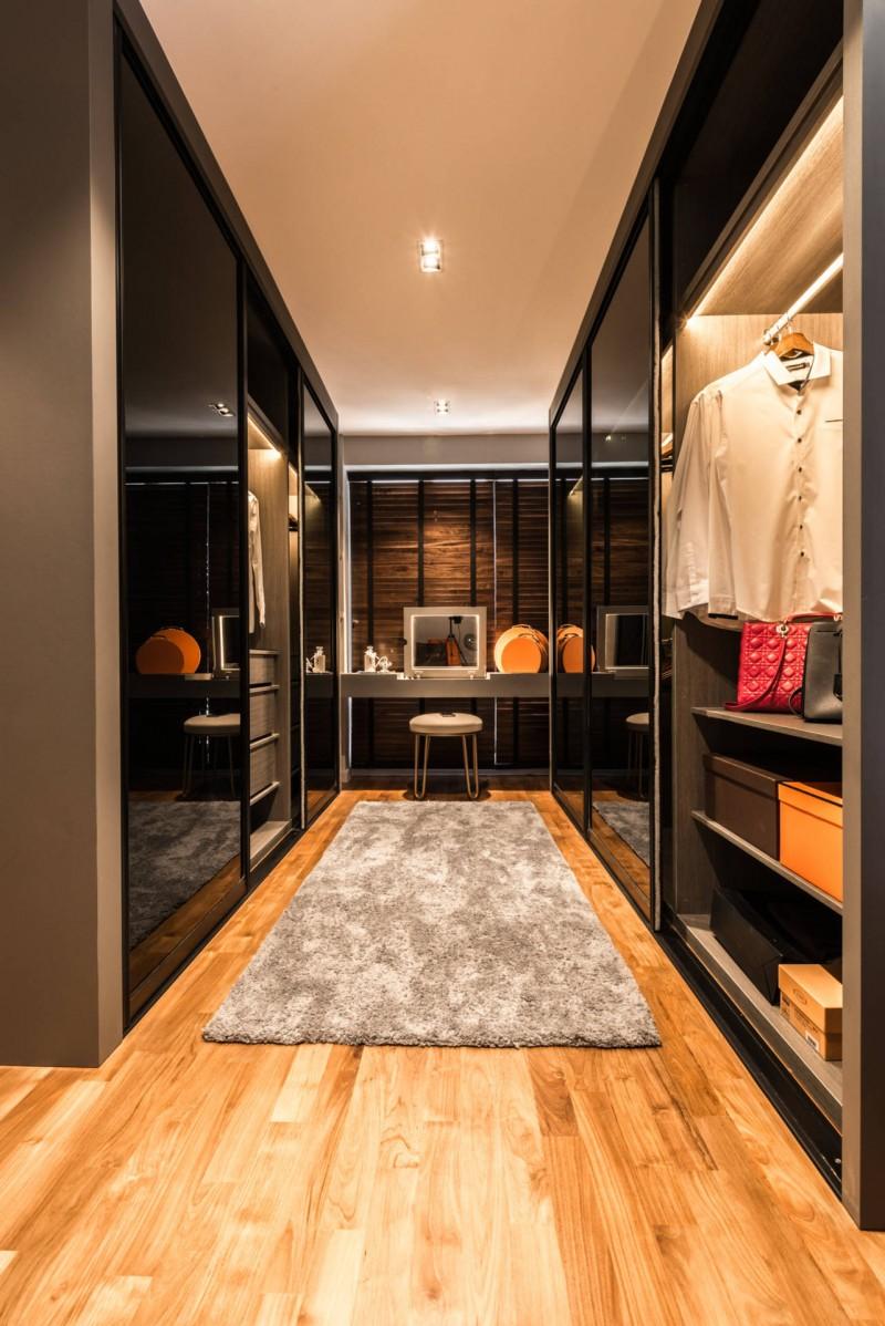 full height closet sliding glass door wooden floor grey rug adjustable shelves