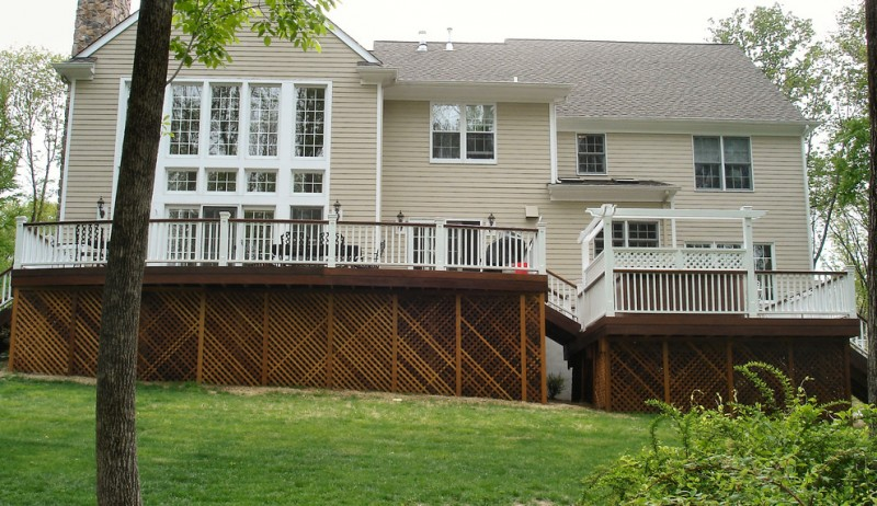 full white wooden made railing system with lattice support at basement