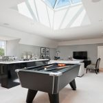 Game Room With Billiard Table, Bar, Living Room With Tv In A Vaulted Ceiling Room
