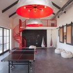 Game Room With Black Tennis Table, White Bean Chairs, White Swing With Red Cushion, Red Modern Pendant Lamps, Red Table