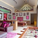 Game Room With Pink Mauve Sofa, Foosball Table, Billiard Table, Pink Stick Storage, Team Jersey Hangings, Private Living Room Upstaris