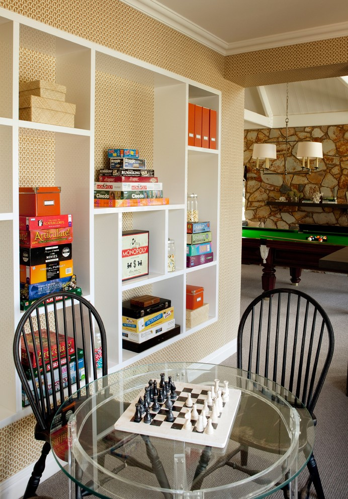 game room with white wooden book shelves, billiard table, black chairs, round glass table