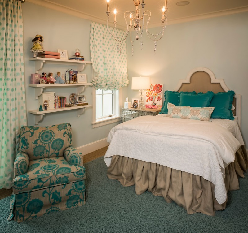 girls' bedroom design with beautiful half window curtains with polka dots an armchair with torquiso flower motifs seagrass rug small wall mounted shelves a bed with classic style headboard