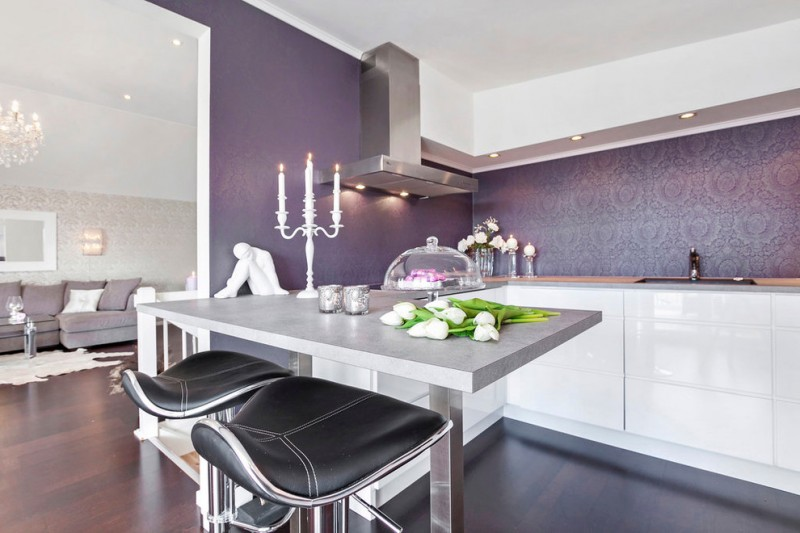 glam kitchen design deep purple walls stainless steel appliances modern bar stools with black leather seaters white marble bar table white flat cabinets