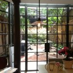 Glass Swing Door With Square Patterned All Over The Door