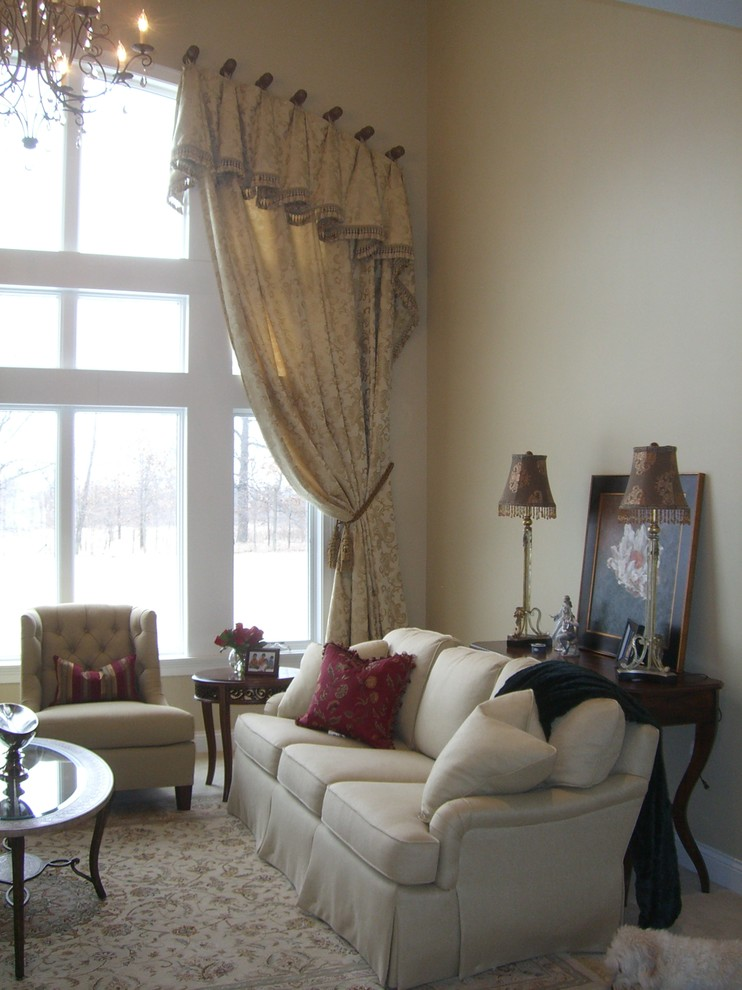 grand living room design with arched window curtain comfy white sofa slipcovers with pillows an armchair rug with floral motifs beautiful classic pendant lamp