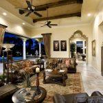 Granite Floor Brown Sofa Ceiling Fans Decorative Archway Wood Beams