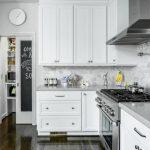 grey quartz countertop white kitchen small size wood floor stove drawers cabinet clock door glass
