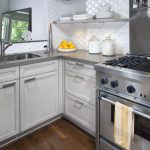 Grey Quartz Countertop White Kitchen Wood Floor Cabinets Floating Shelves Faucet Sink Stove Wall Tiles