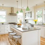 grey quartz countertop white kitchen wood floor dining chairs wall tile hanging lights windows comfy dining room