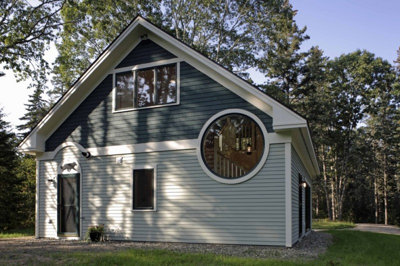 grey siding exterior for garage with multi shapes of exterior windows