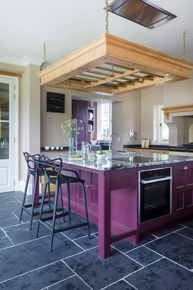 hand made transitional kitchen with hand painted kitchen island in purple and grey marble top stainless steel appliances ceiling hung wooden pot black ceramic floors black stools
