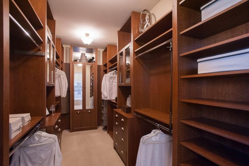 hardwood walk in closet with full features light beige interior
