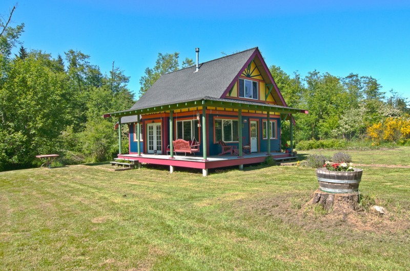 home exterior paint with blue in walls, yellow in upper wall, green in posts, red in porch