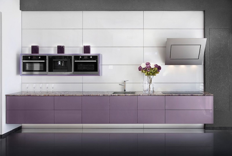hypermodern kitchen design with grey and purple color schemes floating light purple cabinetry grey walls and backsplash