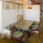 Kitchen Corner With White Built In Ebnch With Green Cushion, Red Chairs With Green Cushion, Wooden Table