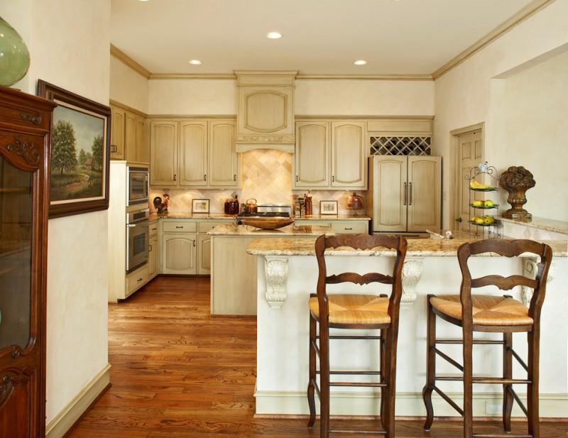 kitchen flooring dark hardwood floor beige cabinets tall chairs door painting wall cabinet ceiling lamp wood