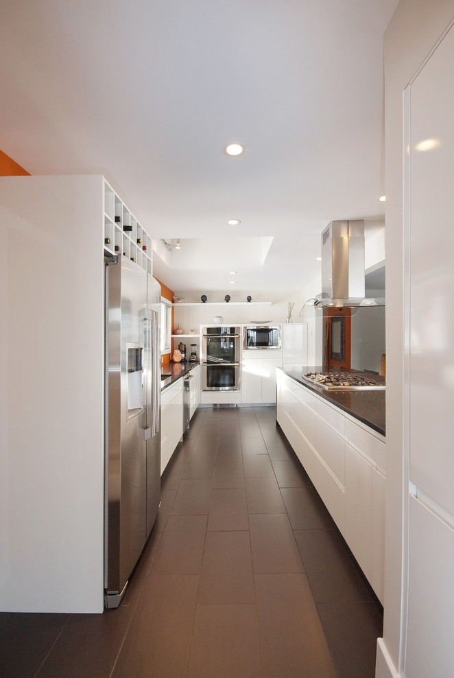 kitchen flooring white wall ceiling lamp storage cooking equipment appliances metal dark colored floor