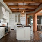 kitchen flooring wood hanging lights tall chairs dining chair wall cabinet storage space stove bricks