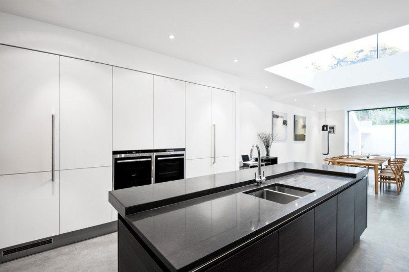 kitchen with white flat cabinet and black cabinet and countertop in the middle of the kitchen