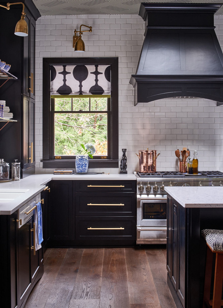 kitchen with white painted brick wall, black window pane, black cabinet with white counter top