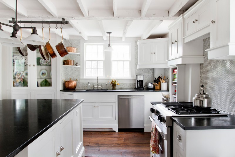 large kitchen with white wall, ceiling, top and below cabinet, but black counter top