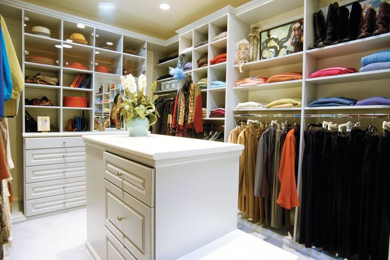 large white melamine walk in closet with white melamine center island with extra drawer system