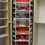 Light Wood Color Walk In Closet With Shoes & Handbags Rack At The Center