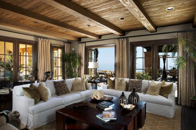 living room with brown walls, dark wooden flooring, wooden ceiling, white sofa, dark wood coffee table, plants