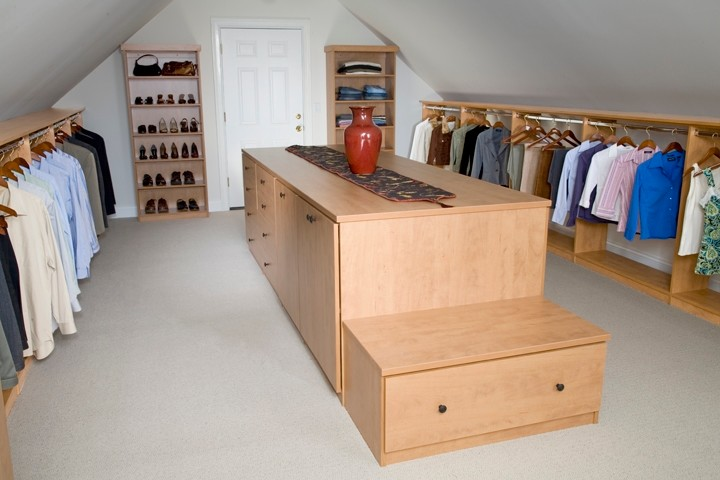 low and slanted roof dressing room idea with separated wooden walk in closet wooden center island with extra storage and integrated wood bench