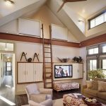 Luxurious Family Room With Loft Ladder Floating TV Console A Set Of Seating Furniture And Table Darker Wood Floors Vaulted Roof Model Long Hallway