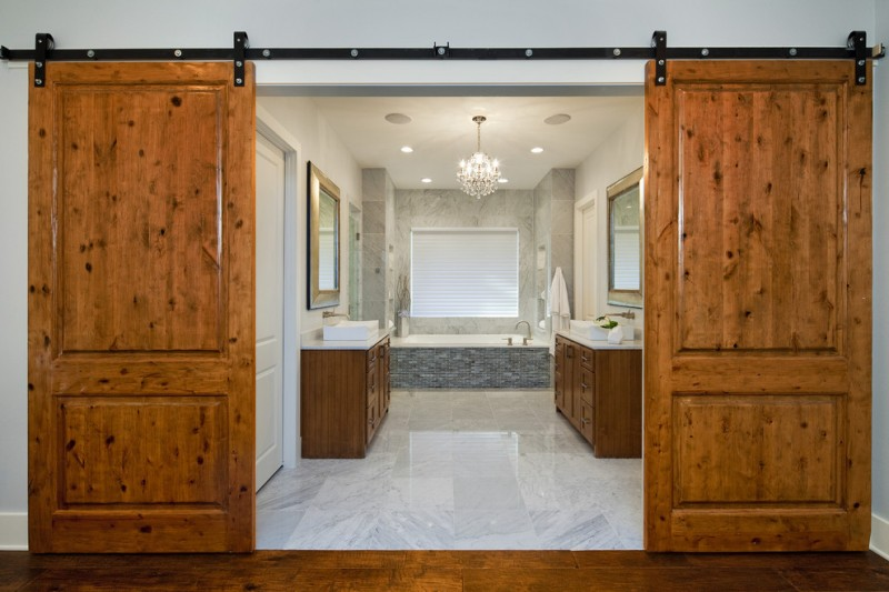 luxurious house door design mirror wooden floor bathtub cabinet faucet towel rack chandelier sliding door