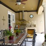 mediterranean summer kitchen with mexico tiles in dining table, brown tiles in counter and top, brown earthy walls