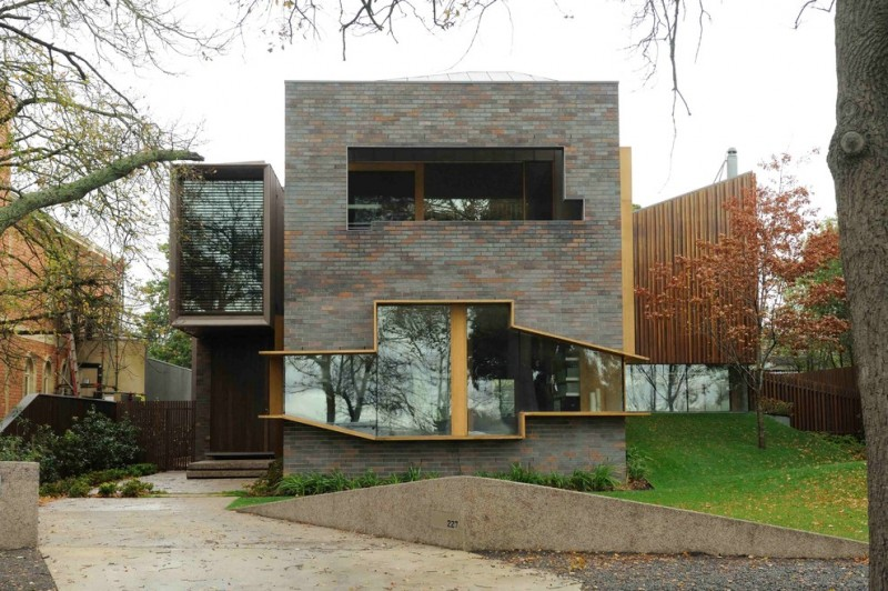 modern exterior with grey bricks walls and unusual windows and entrance door