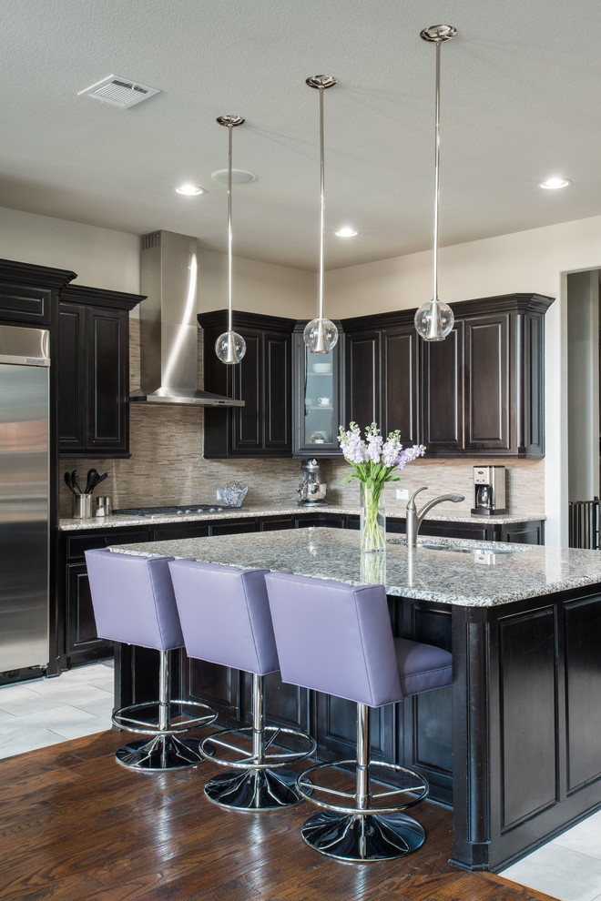 modern kitchen design with lavender schemed stools granite top kitchen island black cabinets grey backsplash granite countertop dark wood floors modern ball pendant lamps stainless steel appliances