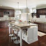 Modern Kitchen With White Island, Dark Wood Cabinet, Wooden Floor, Light Backsplash,white Pendant