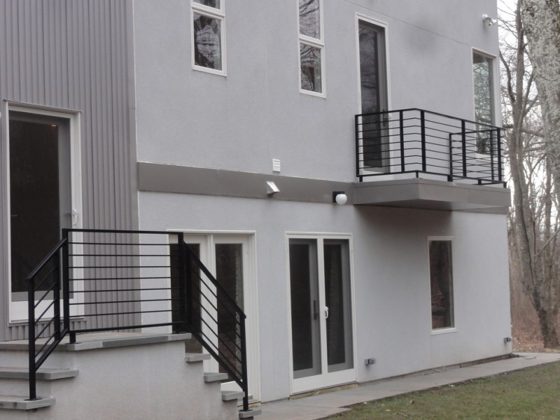 modern metal railings idea in black modern exterior home in grey modern front glass door and modern glass windows