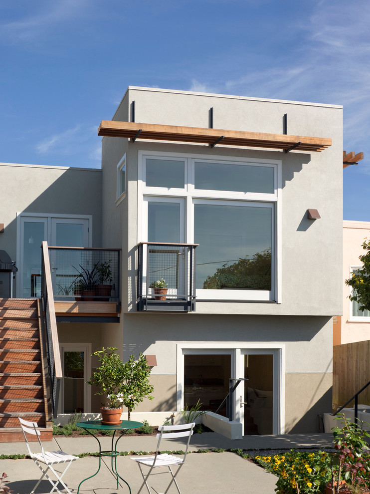 modern minimalist exterior house with exterior glass windows plus their white trims and wood canopy exterior stairs and exterior railing systems
