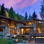 Modern Mountain Homes With Rustic Exterior, The Stone Wall Exterior, The Angled Roof, Many Big Windows, Airy Interior