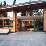 Modern Mountain House With Sleek Angled Roof, Large Yard For Outdoor Gathering, And Modern Comfortable Interior