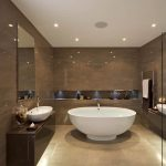 Modern Rounded Free Standing Tub Grey Marble Wall Raised Sink Dark Wooden Cabinet Built In Shelves