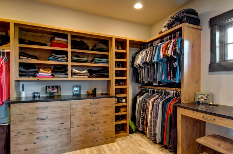 modern rustic walk in closet idea with cool shabby finishing and black & solid top for cabinetry