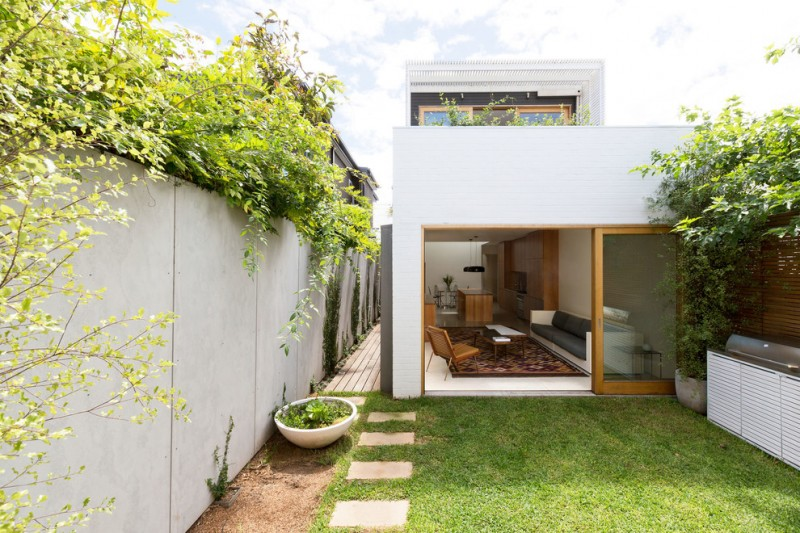 modern square two stories small house in white with yard