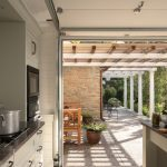 Modern Summer Kitchen Near The Patio With Black Counter Top, Black And White Color Palette